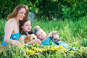 mother, two daughters and dog