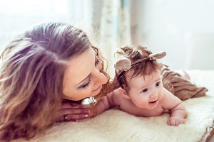 naked baby with mother