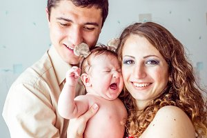parents holding the baby