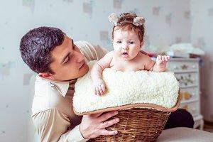 baby sitting in a wicker basket