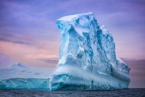 Antarctic iceberg in sunset