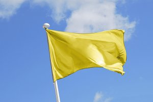 Yellow Flag waving on the wind