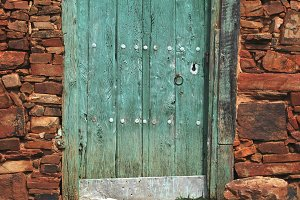 Old door painted in green