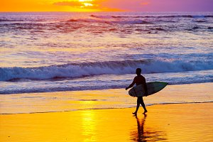Surfer at sunset. Bali island
