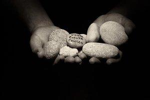 Hands with stones