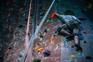 Young Man Climbing Wall