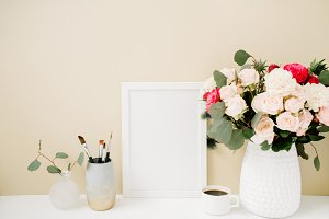 Photo frame near beige wall