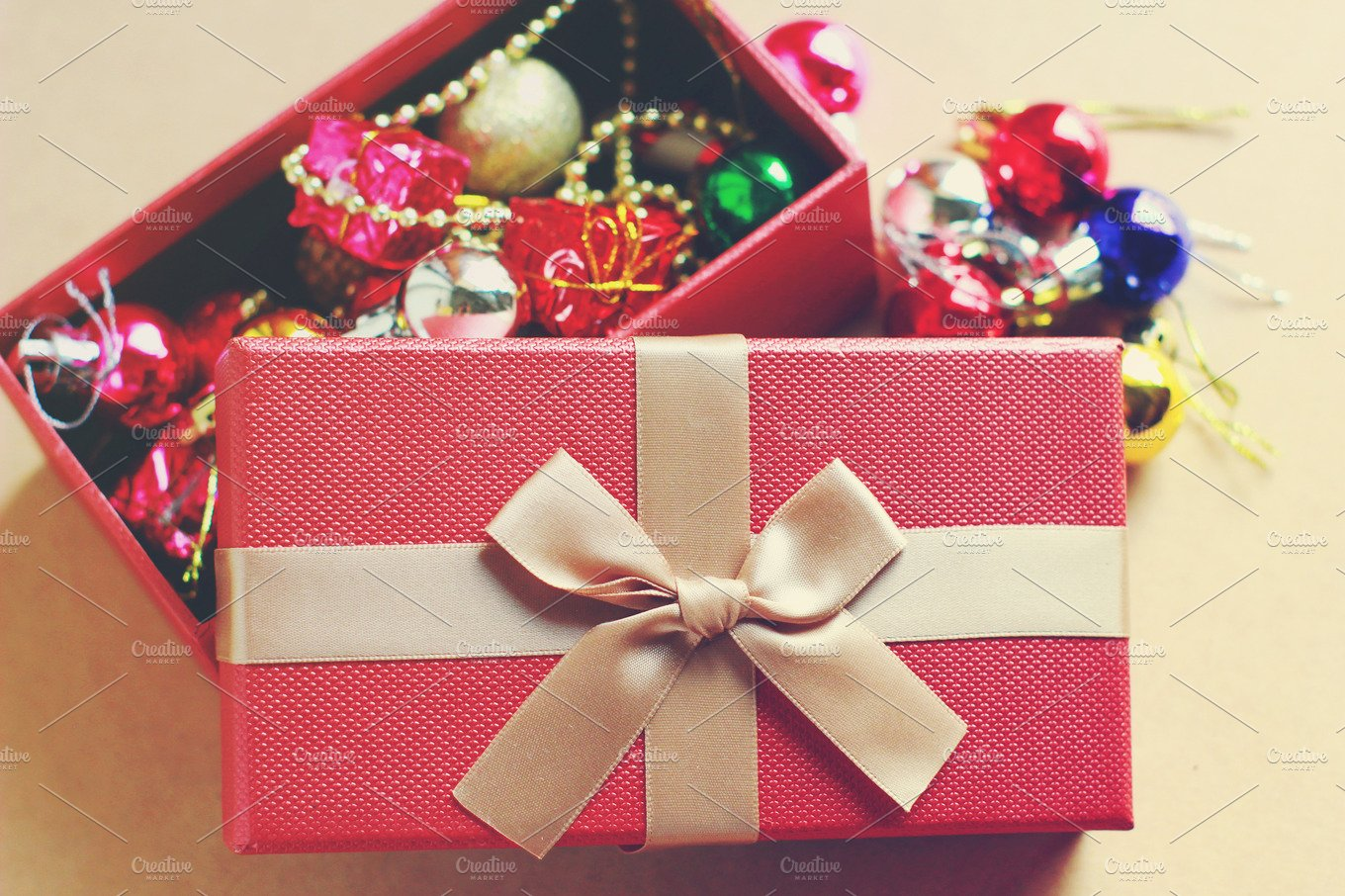 Gift box with christmas ornaments holiday photos
