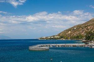 Long stone pier into the sea, Loutraki, Greece