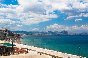 Loutraki embankment in the morning. Aegean sea shore and city beach