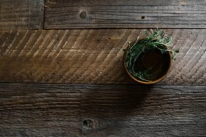 Herbs in a Wood Bowl on Wood Plank