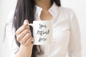 Woman holding white mug mockup