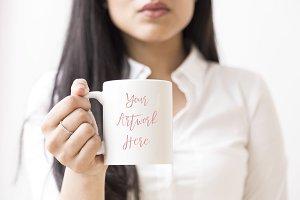 Woman holding blank mug mock up