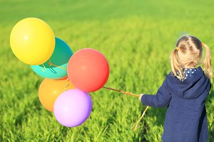 One little girl with balloons