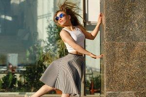 Girl dancing next to shopping center