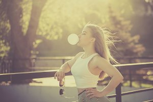 Girl blowing bubble of gum