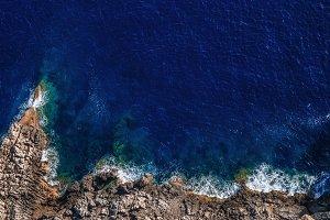 Waves break on the shore