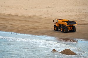 Dump Truck working on sand