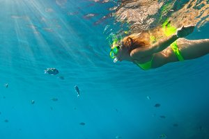 Girl swimming in snorkeling mask