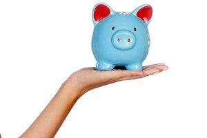 Hand holding a blue moneybox