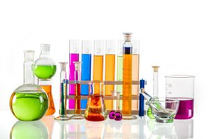 Laboratory glass set filled with colorful substances.