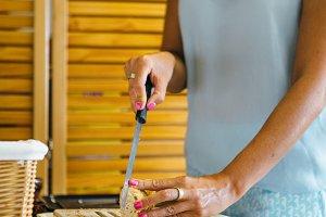 Woman slicing crunchy bread