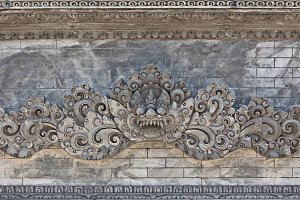 Balinese demon on the temple wall