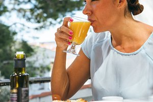 Woman having draught of juice