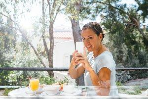 Smiling woman shooting breakfast
