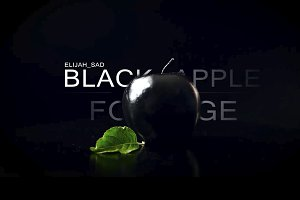 Black apple on a black background