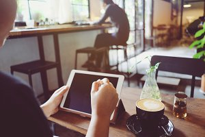 Woman using tablet in the cafe