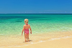 Girl on the ocean sand beach