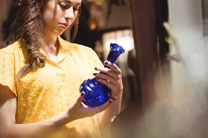 Woman looking at a vintage vase