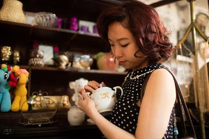 Stylish woman selecting a tea pot