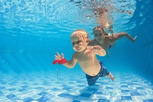 Mother with son swimming underwater