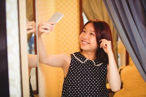 Woman taking selfie from mobile phone