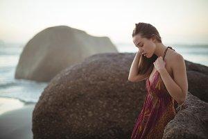 Beautiful woman standing on beach