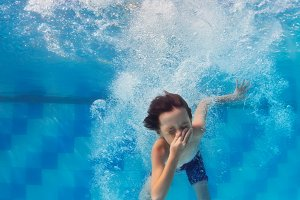 Child jump underwater