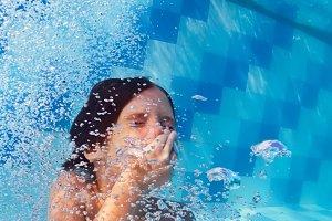 Boy jump underwater
