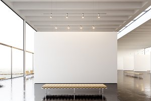 Picture exposition modern gallery,open space.Blank white empty canvas hanging contemporary art museum.Interior loft style concrete floor,light spots,generic design furniture and building.3d rendering