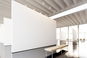 Image exposition modern gallery,open space.Blank white empty canvas hanging contemporary art museum.Interior loft style concrete floor,light spots,generic design furniture and building. 3d rendering