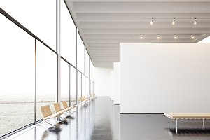 Photo exposition modern gallery,open space.White empty canvas hanging contemporary art museum.Interior loft style with concrete floor,light spots,generic design furniture and building.3d rendering