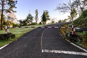Barrier gate on asphalt path.