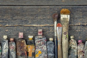 Artist brush and paint tubes