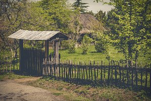 Rural wooden gate and wicker fence