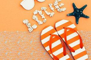 Beach style. Flip-flops, sunglasses