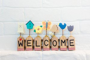 welcome text on the wall background