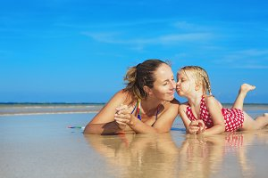 Mother with daughter on sea beach