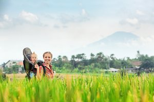 Mother with child walk in rice field