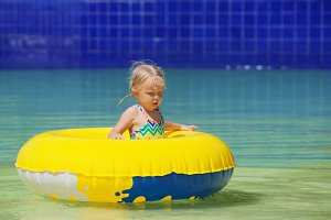 Child in beach club swimming pool